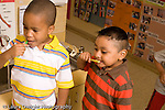 Preschool ages 3-5 two boys brushing teeth same age height difference horizontal