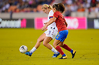 HOUSTON, TX - FEBRUARY 03: Lindsey Horan #9 of the United States passes off a ball past Fabiola Sanchez #5 of Costa Rica during a game between Costa Rica and USWNT at BBVA Stadium on February 03, 2020 in Houston, Texas.