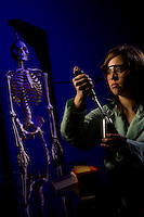A female college student works in the biology lab at a college in Belmont, NC.