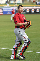 Miguel Montero #26 of the Arizona Diamondbacks warms up before the game against the San Francisco Giants in the first spring training game of the season at Scottsdale Stadium on February 25, 2011  in Scottsdale, Arizona. .Photo by:  Bill Mitchell/Four Seam Images.