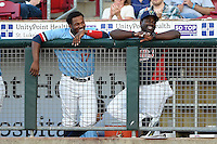 Cedar Rapids Kernels outfielder J.D. Williams (17) and hitting coach Tommy Watkins (8) in the dugout during a game against the Quad Cities River Bandits on August 19, 2014 at Perfect Game Field at Veterans Memorial Stadium in Cedar Rapids, Iowa.  Cedar Rapids defeated Quad Cities 5-3.  (Mike Janes/Four Seam Images)