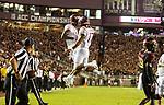 Virginia Tech Hokies wide receiver Damon Hazelton, left, and quarterback quarterback Josh Jackson (17) celebrate a touchdown on their first drive against Florida State during an NCAA college football game in Tallahassee, Fla., Monday, Sept. 3, 2018. (AP Photo/Mark Wallheiser)