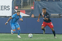 FOXBOROUGH, MA - SEPTEMBER 02: Ronald Matarrita #22 of New York City FC and Brandon Bye #15 of New England Revolution chase down a loose ball during a game between New York City FC and New England Revolution at Gillette Stadium on September 02, 2020 in Foxborough, Massachusetts.
