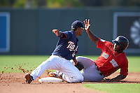 Minnesota Twins shortstop Jermaine Palacios (32) reaches back to tag Josh Ockimey (18) sliding safely into second base during an Instructional League game against the Boston Red Sox on September 24, 2016 at CenturyLink Sports Complex in Fort Myers, Florida.  (Mike Janes/Four Seam Images)
