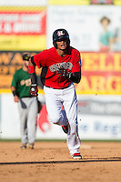 Jairo Beras (5) of the Hickory Crawdads hustles towards third base against the Savannah Sand Gnats at L.P. Frans Stadium on June 14, 2015 in Hickory, North Carolina.  The Crawdads defeated the Sand Gnats 8-1.  (Brian Westerholt/Four Seam Images)