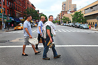 Andrew Coté beekeeper, founder of the New York City Beekeepers' Association, Adam Johnson, a novice, and Troy Seidman, a curious friend, go on foot to inspect the hives in the apiaries in East Village in New York.