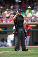 Home plate umpire Jason Johnson indicates there are two warm-up pitches left between innings of the Midwest League game between the West Michigan Whitecaps and the Dayton Dragons at Fifth Third Field on May 29, 2017 in Dayton, Ohio.  The Dragons defeated the Whitecaps 4-2.  (Brian Westerholt/Four Seam Images)
