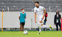 GUADALAJARA, MEXICO - MARCH 24: Mauricio Pineda #5 of the United States head up looking for an open man during a game between Mexico and USMNT U-23 at Estadio Jalisco on March 24, 2021 in Guadalajara, Mexico.