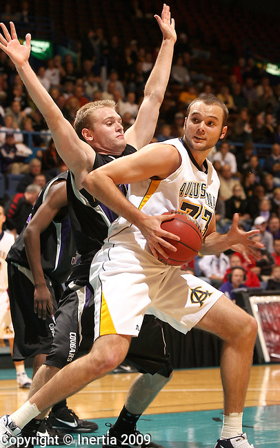 SIOUX FALLS, SD - NOVEMBER 18:  Derek De Zeeuw #33 of Augustana College tries to back down Jack Ridgway #22 of the University of Sioux Falls in the first half of the 2009 Prairie Spirit Charitable Challenge Wednesday night at the Sioux Falls Arena. (Photo by Dave Eggen/Inertia)