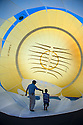 07/08/15<br /> <br /> Nick Langley shows six-year-old Ben Wilkinson the inside of his Minion balloon which is valued at £100,000. <br /> <br /> Hundreds of hot air balloons take to the skies on the second day of three <br /> day Bristol International Balloon Fiesta.<br /> <br /> All Rights Reserved - F Stop Press.  www.fstoppress.com. Tel: +44 (0)1335 418629 +44(0)7765 242650