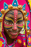 A woman in elaborate make-up poses for her portrait before the start of the street parade for the ZomerCarnaval (Summer Carnival) in Rotterdam, the Netherlands.  The street parade is the colorful high point of the Rotterdam carnival. It is a tropical themed parade with over 2000 participants and travels 6km through the center of Rotterdam.