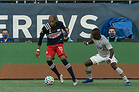 FOXBOROUGH, MA - SEPTEMBER 23: Teal Bunbury #10 of New England Revolution attempts to control the ball as Zachary Brault-Guillard #15 of Montreal Impact defends during a game between Montreal Impact and New England Revolution at Gillette Stadium on September 23, 2020 in Foxborough, Massachusetts.