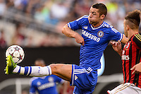 Chelsea F. C. defender Gary Cahill (24) plays the ball. Chelsea F. C. defeated A. C. Milan 2-0 during round two of the 2013 Guinness International Champions Cup at MetLife Stadium in East Rutherford, NJ, on August 04, 2013.