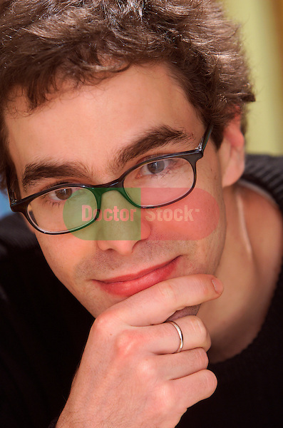 portrait of young man with eyeglasses
