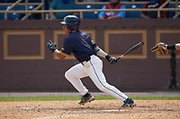 Alex Reyna (5) of the North Carolina A&T Aggies follows through on his swing against the North Carolina Central Eagles at Durham Athletic Park on April 10, 2021 in Durham, North Carolina. (Brian Westerholt/Four Seam Images)