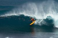 Surfer enjoys waves and kona winds at Ho'okipa Beach Park, Maui.