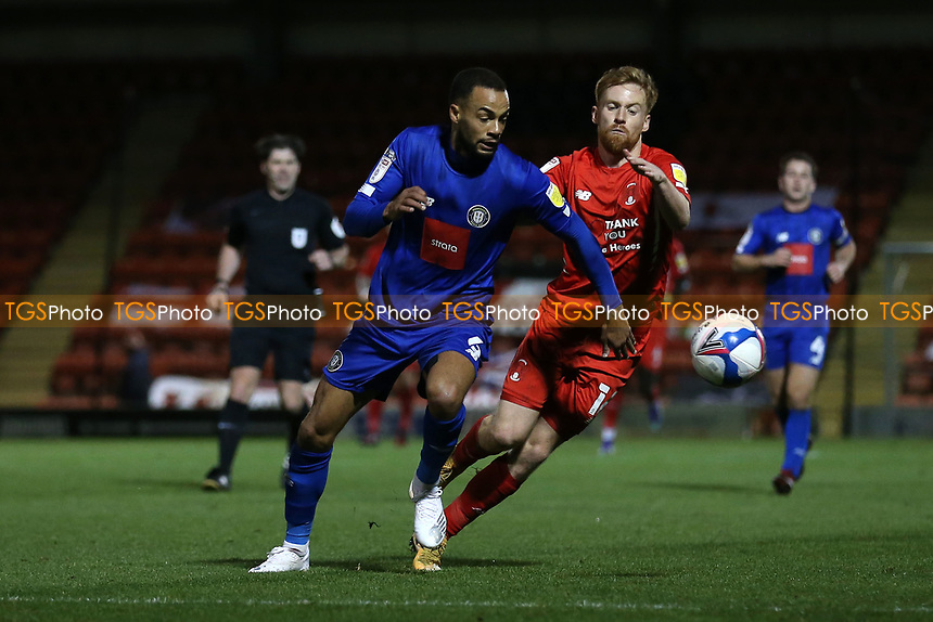 Warren Burrell of Harrogate Town and James Brophy of Leyton Orient during Leyton Orient vs Harrogate Town, Sky Bet EFL League 2 Football at The Breyer Group Stadium on 21st November 2020