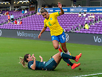 ORLANDO, FL - FEBRUARY 18: Clarisa Huber #8 of Argentina tackles Tamires #6 of Brazil during a game between Argentina and Brazil at Exploria Stadium on February 18, 2021 in Orlando, Florida.