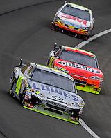 Feb 22, 2009; Fontana, CA, USA; NASCAR Sprint Cup Series driver Jimmie Johnson leads Jeff Gordon and Greg Biffle during the Auto Club 500 at Auto Club Speedway. Mandatory Credit: Mark J. Rebilas-