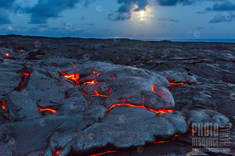 The full moon rises and lights the lava fields of Hawai'i Volcanoes National Park, Island of Hawai'i.