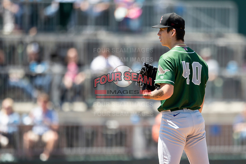 Great Lakes Loons pitcher Bobby Miller (40) looks to his catcher for the sign on May 30, 2021 against the Lansing Lugnuts at Jackson Field in Lansing, Michigan. (Andrew Woolley/Four Seam Images)