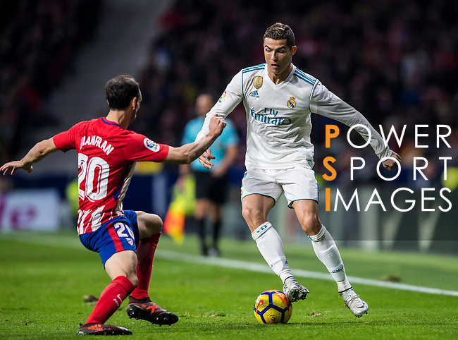 Cristiano Ronaldo (r) of Real Madrid battles for the ball with Juan Francisco Torres Belen, Juanfran, of Atletico de Madrid  during the La Liga 2017-18 match between Atletico de Madrid and Real Madrid at Wanda Metropolitano  on November 18 2017 in Madrid, Spain. Photo by Diego Gonzalez / Power Sport Images