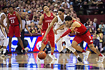Florida State guard Devin Vassell (24) attempts a steal from Louisville guard Lamarr Kimble (0) in the second half of an NCAA college basketball game in Tallahassee, Fla., Monday, Feb. 24, 2020. Florida State defeated Louisville 82-67.  (AP Photo/Mark Wallheiser)