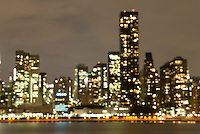 AVAILABLE FROM JEFF AS A FINE ART PRINT<br /> <br /> Defocused View of Midtown Manhattan Skyline Illuminated at Night, New York City, New York State, USA