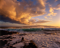 Wave Breaking on Shoreline at Sunset, Ahihi Bay, Maui, Hawaii, USA.