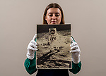 Pictured: Sales Coordinator Lulu Randall holds up  an original print of Buzz Aldrin, taken by fellow astronaut Neil Armstrong in 1972 as part of the Apollo 11 moon landings with an estimated value of £2,000-£3,000 ahead of auction today [WEDNESDAY] at Dreweatts Auction House in Newbury, Berks.<br /> <br /> A rare front bodied portrait of Buzz Aldrin, taken by fellow astronaut Neil Armstrong is one of the most iconic images from the Apollo 11 mission. The reflection of Armstrong in this image makes it exceptionally rare. It was so breath-taking that it featured on the front cover of Time Magazine.<br /> <br /> Some of the most historic photographs chronicling the history of man's exploration of space, from early expeditions, to some of the latter trips of the 1990s will be sold at auction.  Over 600 images, many of which capture historic moments, such as the first humans in space, the first spacewalk and the first moon landing will be auctioned today on March 17th 2021 as part of the Space Exploration Photography and Ephemera auction by Dreweatts.<br /> <br /> © Jordan Pettitt/Solent News & Photo Agency<br /> UK +44 (0) 2380 458800
