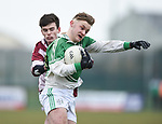 Kealan Guyler of  Ennistymon CBS  in action against John Sheahan of  St Declan's Kilmacthomas during their Munster C Colleges football final at Rathkeale. Photograph by John Kelly.