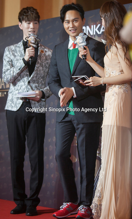 Julian Cheung from Hong Kong, winner of the Annual Goodwill Star Award, is seen on the red carpet at the 18th Channel [V] China Music Awards and Asian Influential Power Grand Ceremony at the Venetian Macau Casino in Macau, China, 23 April 2014