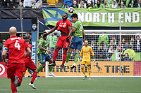 SEATTLE, WA - NOVEMBER 10: Jozy Altidore #17 of Toronto FC and Kim Kee-hee #20 of the Seattle Sounders FC challenge for a header during a game between Toronto FC and Seattle Sounders FC at CenturyLink Field on November 10, 2019 in Seattle, Washington.