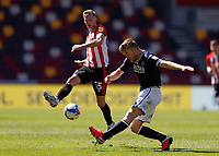 17th April 2021; Brentford Community Stadium, London, England; English Football League Championship Football, Brentford FC versus Millwall; Alex Pearce of Millwall crosses the ball past Marcus Forss of Brentford