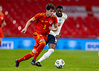8th Occtober 2020, Wembley Stadium, London, England;  Wales Neco Williams breaks away from Englands Ainsley Maitland-Niles during a friendly match between England and Wales in London