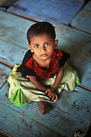 This toddler who lost her parents to the tsunami was found living in an abandoned school in Ampara, Sri Lanka, 2005.