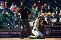 Home plate umpire Ron Teague makes a strike call during the game between the Missouri Tigers and the Baylor Bears in game one of the 2020 Shriners Hospitals for Children College Classic at Minute Maid Park on February 28, 2020 in Houston, Texas. The Bears defeated the Tigers 4-2. (Brian Westerholt/Four Seam Images)