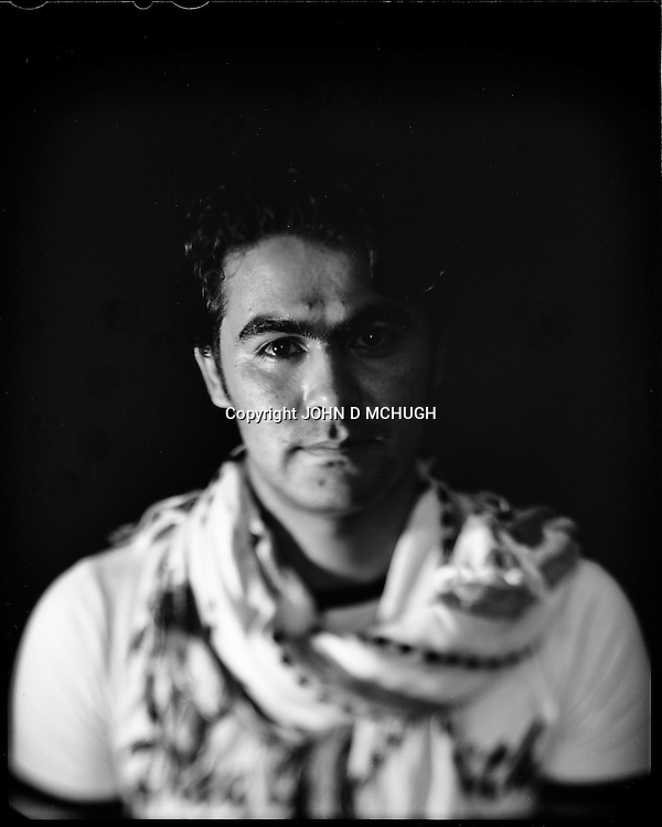 """Noorullah Noory, a young Afghan businessman, is seen in his internet cafe in Kabul, 28 August 2012. This portrait was shot on a 5x4 Linhof Technika IV, circa 1959, and a Schneider Kreuznach 270mm lens, circa 1952, with front tilt, and is part of a series entitled """"Putting an Afghan face on the war."""" (John D McHugh)"""