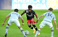 WASHINGTON, DC - NOVEMBER 8: Moses Nyeman #27 of D.C. United battles for the ball with Jorge Corrales #26 of Montreal Impact and Amar Sejdic #14 of Montreal Impact during a game between Montreal Impact and D.C. United at Audi Field on November 8, 2020 in Washington, DC.