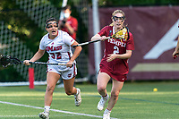 NEWTON, MA - MAY 14: Mackenzie Roth #2 of Temple University behind the net as Kelsie Callahan #32 of University of Massachusetts defends during NCAA Division I Women's Lacrosse Tournament first round game between University of Massachusetts and Temple University at Newton Campus Lacrosse Field on May 14, 2021 in Newton, Massachusetts.