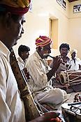 66-year-old Manganiyar artist, Pempa Khan plays his Murli (wind instrument) while Ghewar Khan (45, Left) and Firoze Khan (38, right) accompany him during field recordings inside their house in Hamira village of Jaiselmer district in Rajasthan, India. Photo: Sanjit Das/Panos