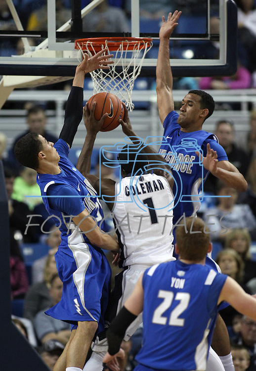 Air Force defenders Hayden Graham, left, and Kamryn Williams, right, block Nevada's Marqueze Coleman during an NCAA basketball game in Reno, Nev., on Saturday, Feb. 1, 2014. Nevada won 69-56 in overtime. Air Force's Max Yon is at bottom right. (AP Photo/Cathleen Allison)