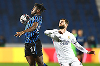 Duvan Zapata of Atalanta and Nacho Fernandez of Real Madrid compete for the ball during the Champions League round of 16 football match between Atalanta BC and Real Madrid at Atleti azzurri d'Italia stadium in Bergamo (Italy), February, 24th, 2021. Photo Image Sport  / Insidefoto