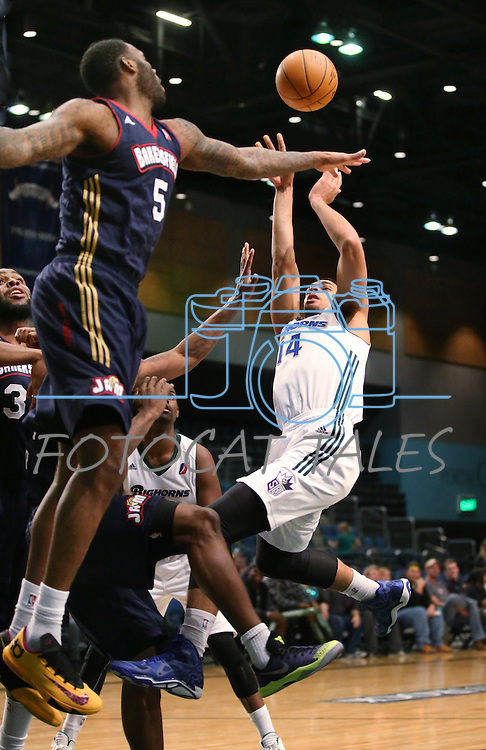 Reno Bighorns' Trent Lockett shoots over Bakersfield Jam's Damion James during a D-League basketball game in Reno, Nev., on Tuesday, Jan. 14, 2014. The Bighorns won 93-85.<br /> Photo by Cathleen Allison