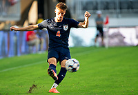 WASHINGTON, DC - SEPTEMBER 6: Virginia defender Paul Wiese (4) sends over a cross during a game between University of Virginia and University of Maryland at Audi Field on September 6, 2021 in Washington, DC.