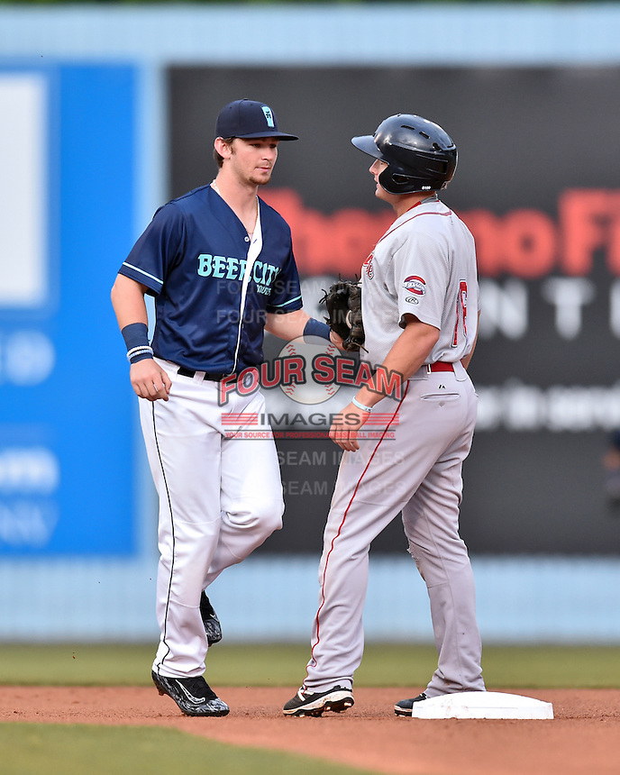 Beer City Tourists shortstop Brendan Rodgers (1) tags out Tate Matheny (16) to complete a double play during a game against the  Greenville Drive at McCormick Field on June 2, 2016 in Asheville, North Carolina. The Drive defeated the Tourists 5-2. (Tony Farlow/Four Seam Images)