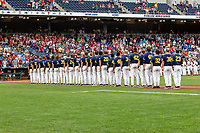 Michigan Wolverines stand during the National Anthem before Game 6 of the NCAA College World Series against the Florida State Seminoles on June 17, 2019 at TD Ameritrade Park in Omaha, Nebraska. Michigan defeated Florida State 2-0. (Andrew Woolley/Four Seam Images)