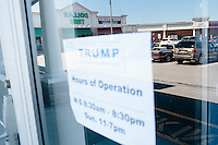The Rhode Island state campaign headquarters for Republican presidential candidate Donald Trump are located between a hockey equipment store and a pizzeria in the Airport Plaza strip mall in Warwick, Rhode Island, USA, on Sun., Apr. 24, 2016. A Dollar Tree store, reflected in the window, occupies part of the strip mall. The campaigns of Trump, Cruz, and Kasich, have all set up offices in the strip mall.