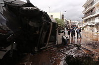 Pictured: Local people inspect a pile of cars in the middle of the road.<br /> Re: Five people have reportedly died and severe damage caused by heavy rain and flash flooding in the area of Mandra, near Athens, Greece. Wednesday 15 November 2017