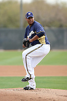 Wily Peralta #73 of the Milwaukee Brewers participates in pitchers fielding practice during spring training workouts at the Brewers complex on February 18, 2011  in Phoenix, Arizona. .Photo by Bill Mitchell / Four Seam Images.